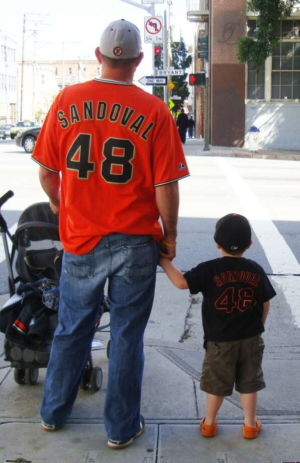 This father and son are Giants fans. Photo: Heather-uriarte