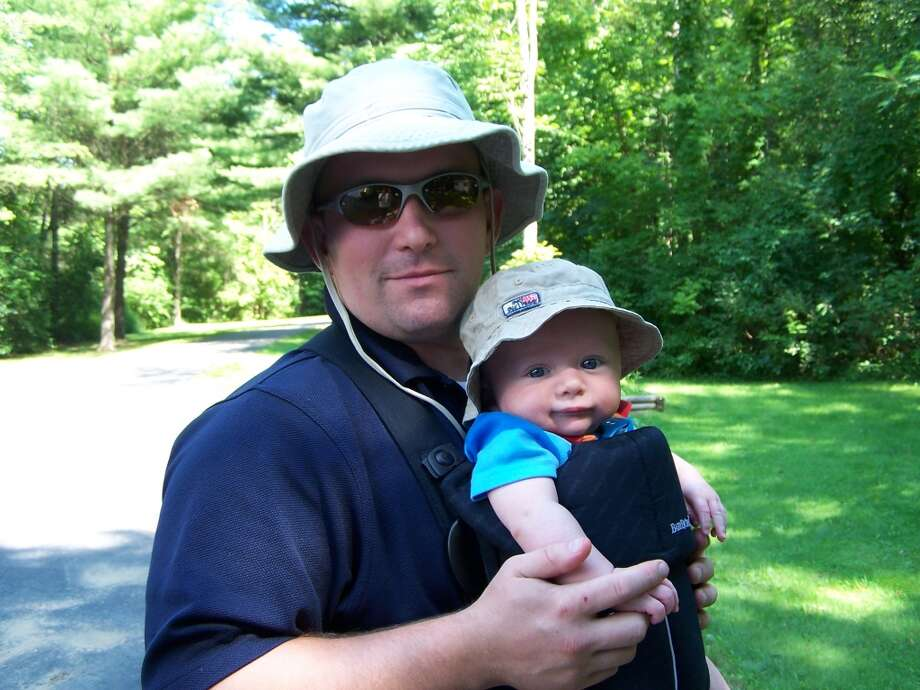 Some fathers and sons wear practical hats.
