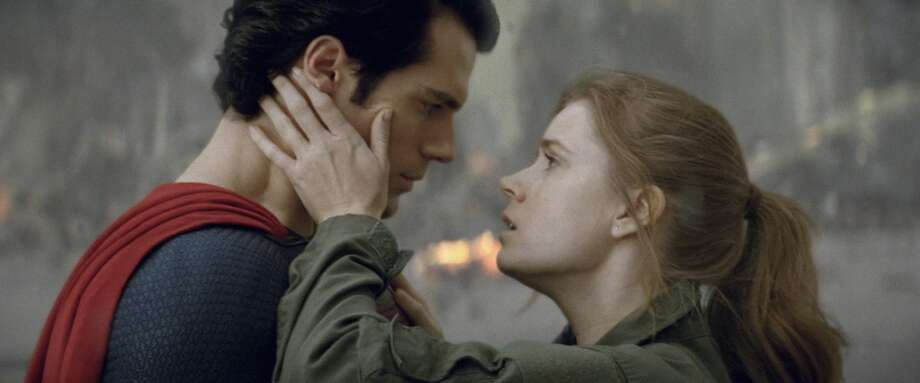 "(L-r) HENRY CAVILL as Superman and AMY ADAMS as Lois Lane in Warner Bros. Pictures' and Legendary Pictures' action adventure ""MAN OF STEEL,"" a Warner Bros. Pictures release."