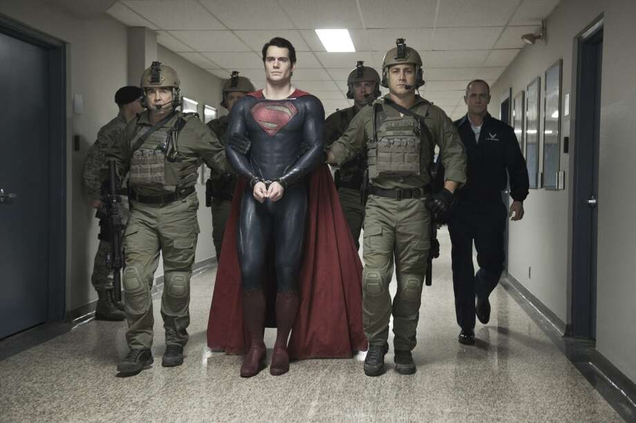 "HENRY CAVILL (center) as Superman and CHRISTOPHER MELONI (far right) as Colonel Nathan Hardy in Warner Bros. Pictures' and Legendary Pictures' action adventure ""MAN OF STEEL,"" a Warner Bros. Pictures release."