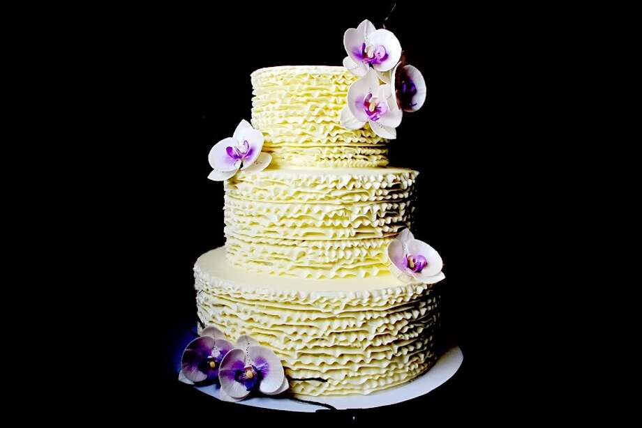 Butter cream with sugar orchids by Beyond Buttercream. Photo: Picasa
