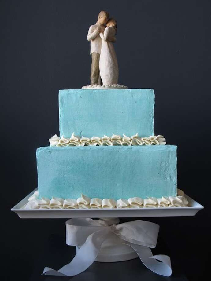 Ice blue sculptured cake by Beyond Buttercream.