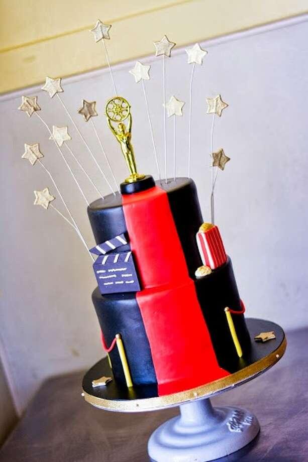 Black fondant cake with handmade movie elements by Beyond Buttercream.