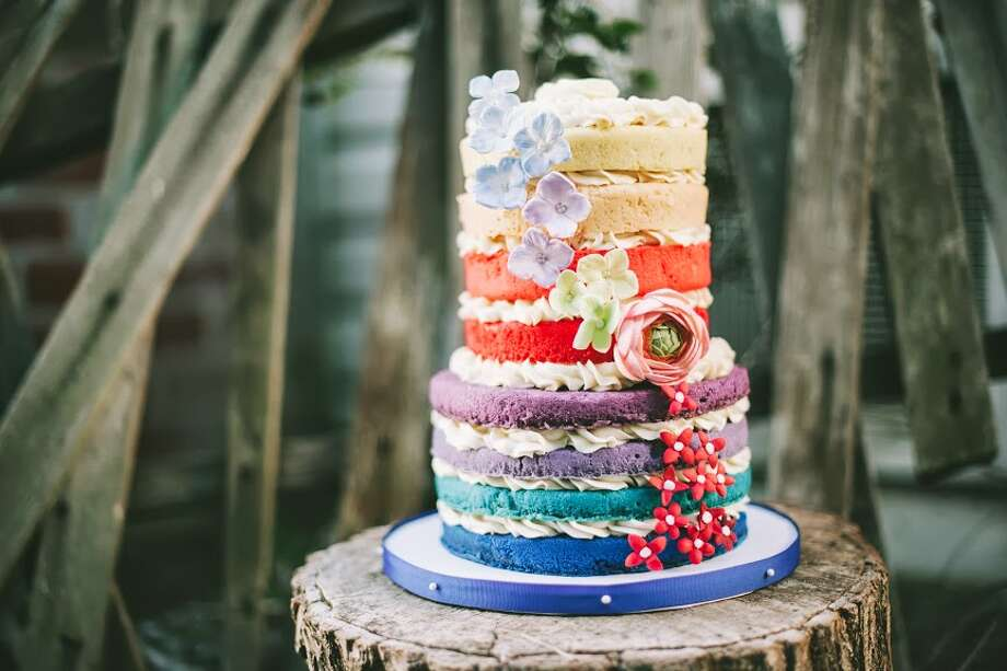 Beyond Buttercream's multi colored, multi tiered cake. Photo: Michael James Buchanan / Michael James Photography