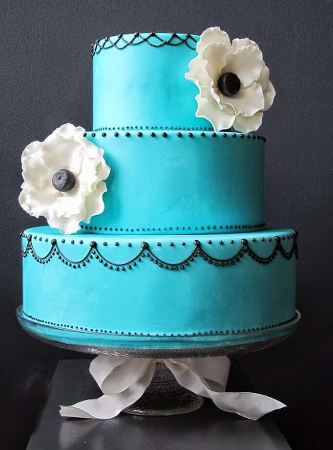 Blue fondant, black royal icing piping sugar flowers by Beyond Buttercream.