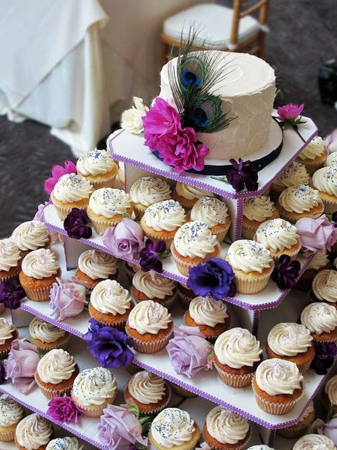 Cupcake tower with centerpiece by Beyond Buttercream.