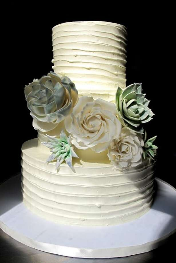 Buttercream cake with handmade sugar succulents by Beyond Buttercream. Photo: Picasa