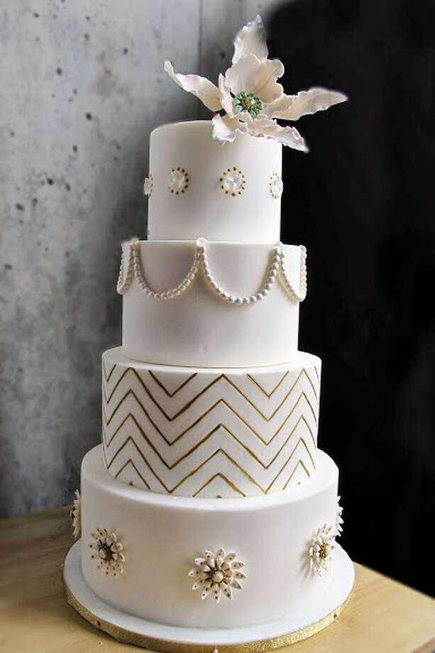 White fondant cake with gold chevrons sugar broaches and pearls with diamonds-handmade sugar flowering by Beyond Buttercream. Photo: Picasa