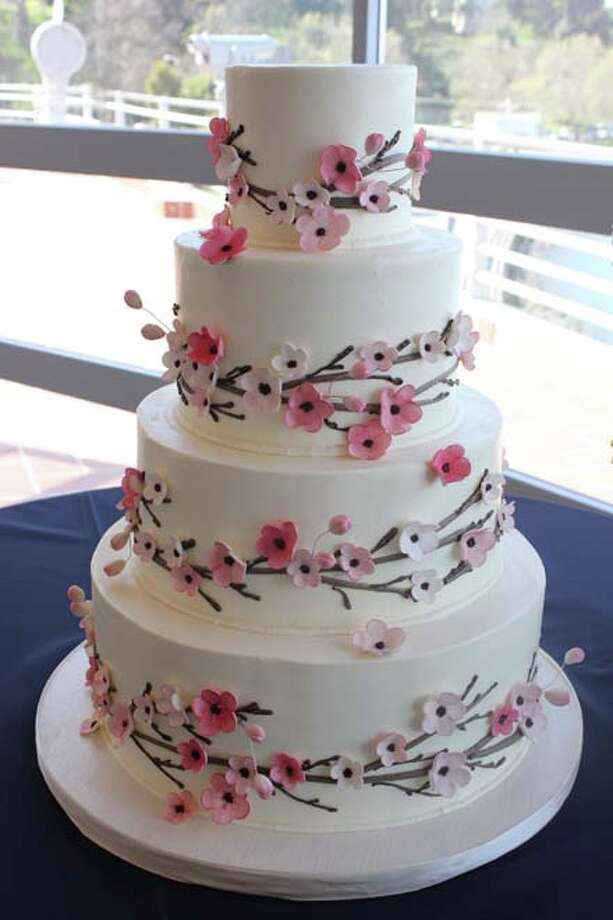 """Cherry blossoms"" - iced in buttecream with piped branches and hand made and colored sugar blossoms by Cake Coquette."