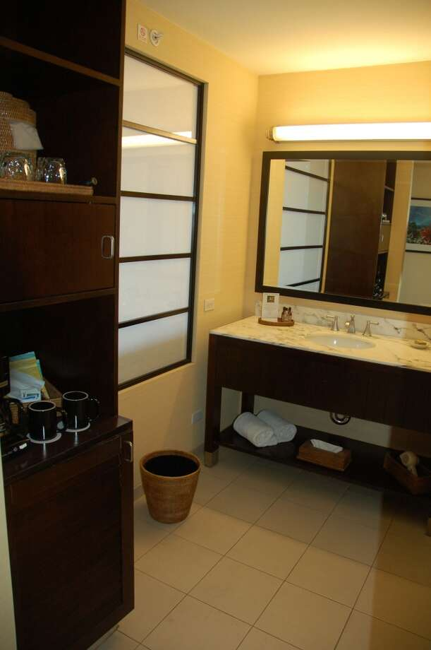 Bathrooms are large and light-filled, thanks to a shoji screen separating the vanity and hospitality area from the bedroom.