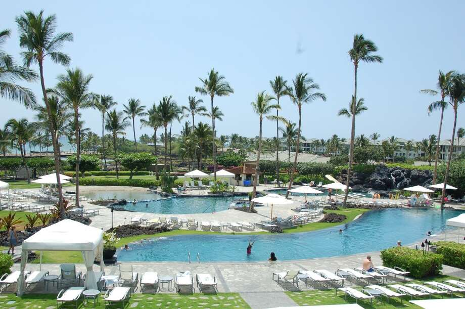 Although condos crowd the view to the north, the spacious grounds of the Waikoloa Beach Marriott  allow guests to spread out under majestic palms.