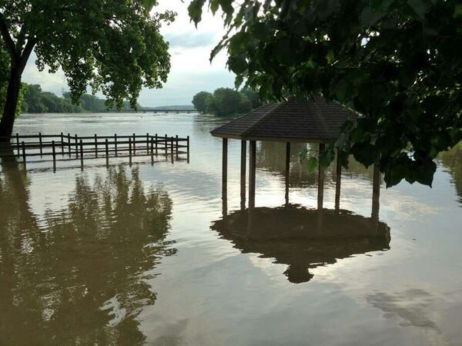 A gazebo near Schenectady County Community College is under water as the Mohawk River spills over its banks Friday morning, June 14, 2013. Photo: Skip Dickstein