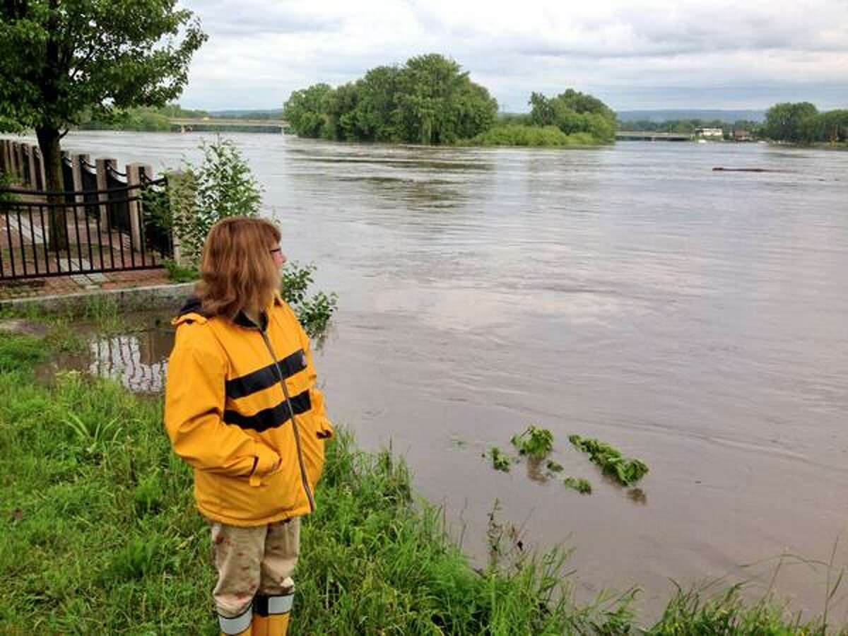 North Street resident Betsy Meyer watches the level of the Mohawk River in Riverside Park in Schenectady Friday morning, June 14, 2013.