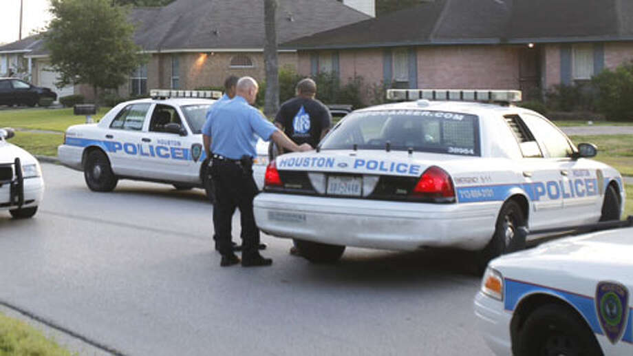 A man has been taken into custody after he held officers at bay Friday morning following an alleged attack on a woman at a home in southeast Houston. The standoff began about 4:30 a.m. at a home on Donegal Way near Almeda Genoa, according to the Houston Police Department. Photo: (Cody Duty / Houston Chronicle)