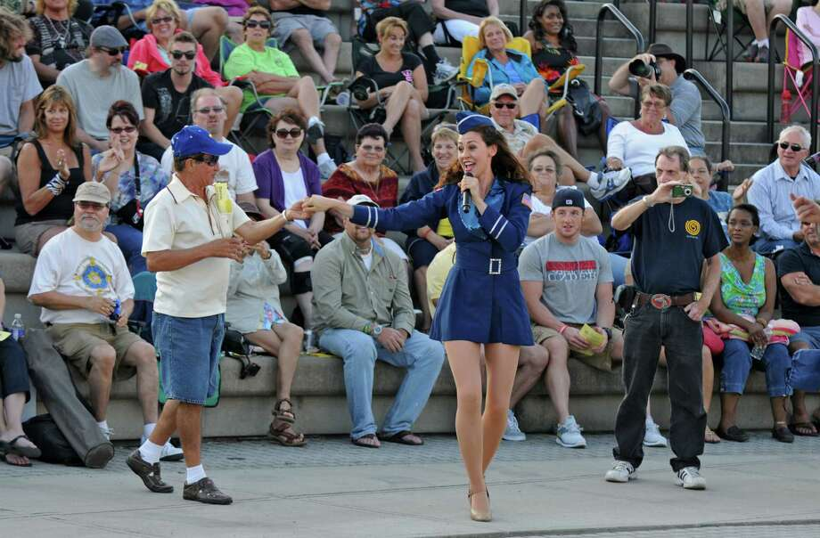 A member of the U.S.O. Liberty Bells dances with a member of the audience during their performance at the 10th Annual Albany Father's Day Concert at Albany Riverfront Park, on Sunday evening June 17, 2012 in Albany, NY. (Philip Kamrass / Times Union) Photo: Philip Kamrass / 00018105A