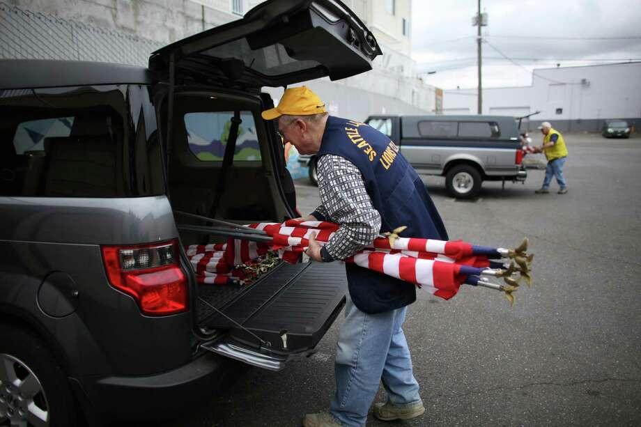 Tom Lentz of the Lake City Lions Club gathers flags as a crew of Lions Club members head out to place flags on businesses in north Seattle and Shoreline on Flag Day, Friday, June 14, 2013. Photo: JOSHUA TRUJILLO, SEATTLEPI.COM / SEATTLEPI.COM