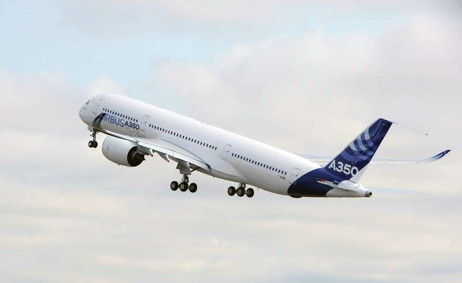 Airbus's next-generation A350 plane takes off. AFP PHOTO / ERIC CABANIS Photo: ERIC CABANIS, Getty / 2013 AFP