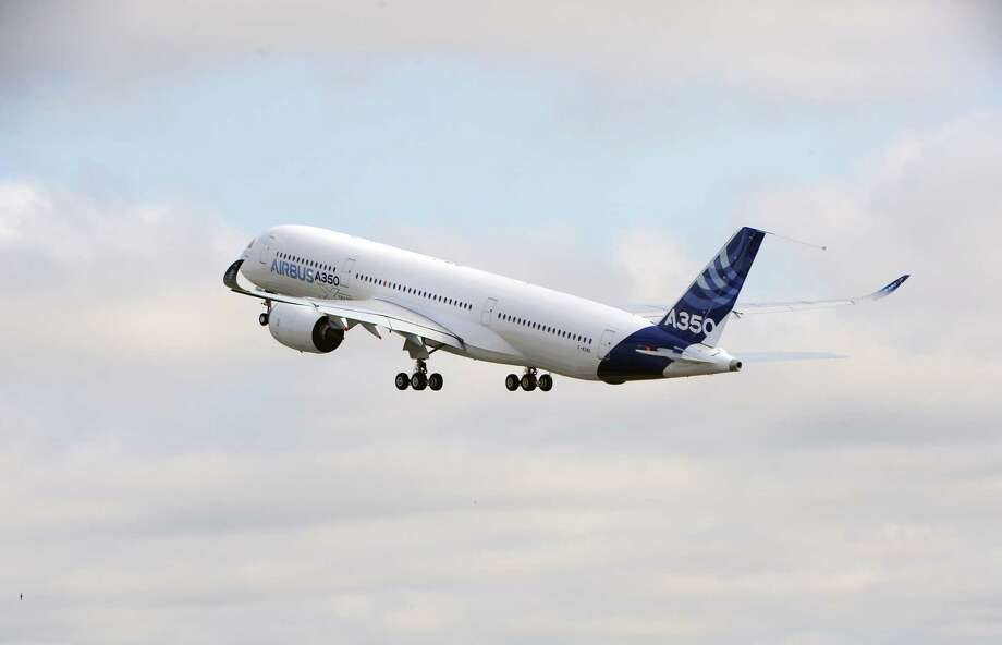 Airbus's next-generation A350 plane takes.  AFP PHOTO / ERIC CABANIS Photo: ERIC CABANIS, Getty / 2013 AFP