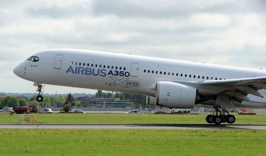 Airbus's next-generation A350 plane takes off from Toulouse-Blagnac airport, southwestern France, on its first test flight on Friday.   AFP PHOTO / ERIC CABANIS Photo: ERIC CABANIS, Getty / 2013 AFP