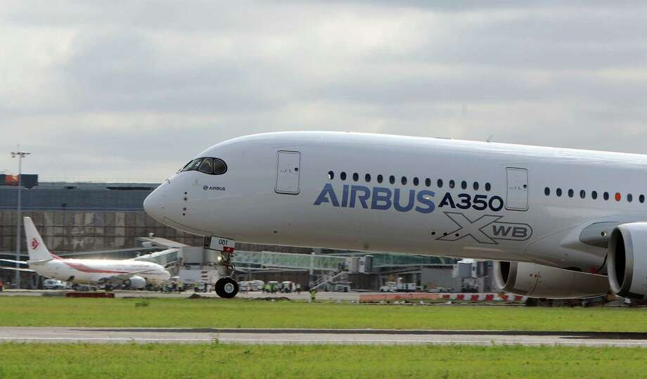Airbus's next-generation A350 plane takes off from Toulouse-Blagnac airport, southwestern France, on its first test flight on Friday, June 14, 2013, in a milestone for an airliner that the firm hopes will challenge Boeing's 787 Dreamliner in the lucrative long-haul market.   AFP PHOTO / ERIC CABANIS Photo: ERIC CABANIS, Getty / 2013 AFP