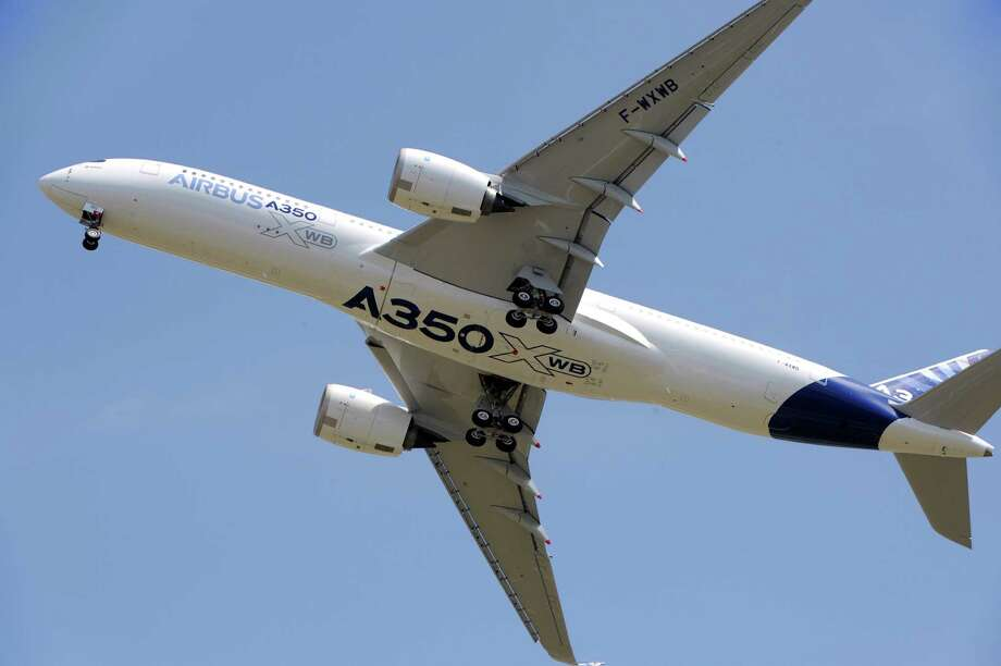 Airbus's next-generation A350 plane flies over Toulouse-Blagnac airport.    AFP PHOTO / ERIC CABANIS Photo: ERIC CABANIS, Getty / 2013 AFP