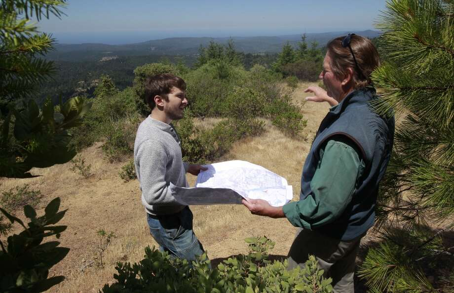 Brian Pickett, a forester, (left)  and Chris Kelly, the California Director for The Conservation Fund along a ridge high above the Preservation Ranch property on Tues. June 11, 2013 near Annapolis, Calif.