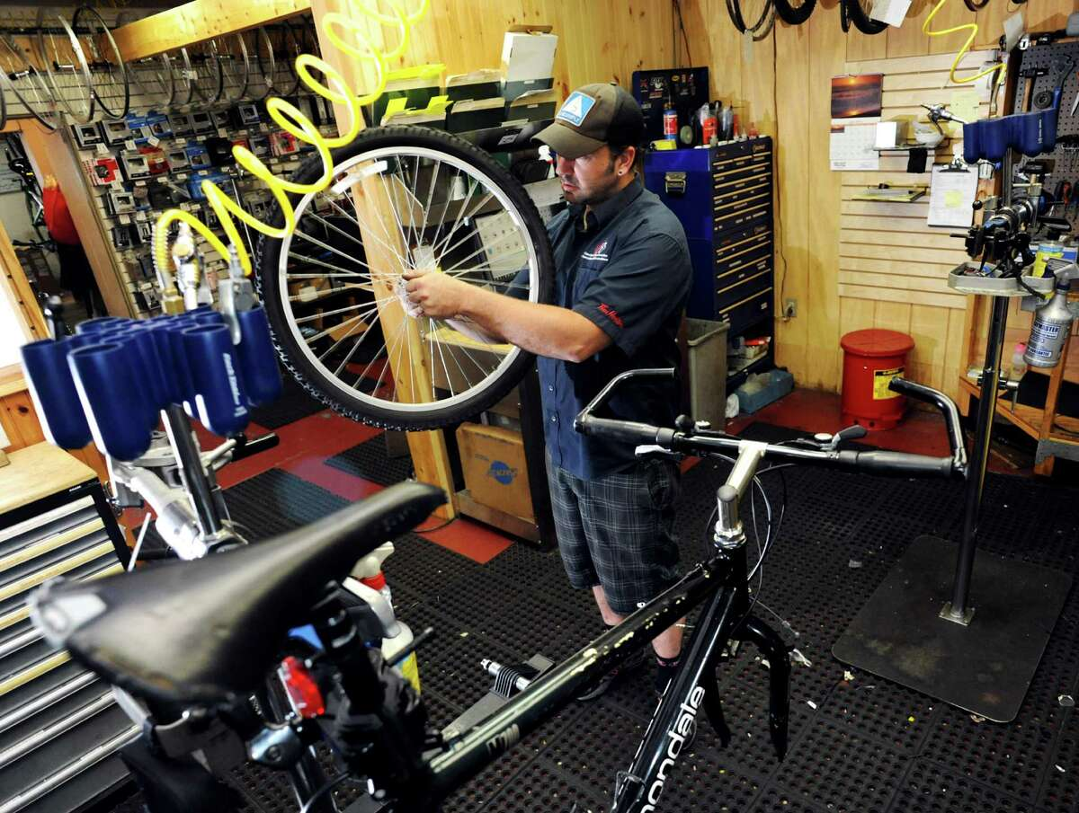 Bike mechanic Dave Drumm works on an early 90s Cannondale mountain bike on Wednesday, June 12, 2013 at Blue Sky Bicycles in Saratoga Springs, NY (Cindy Schultz / Times Union)