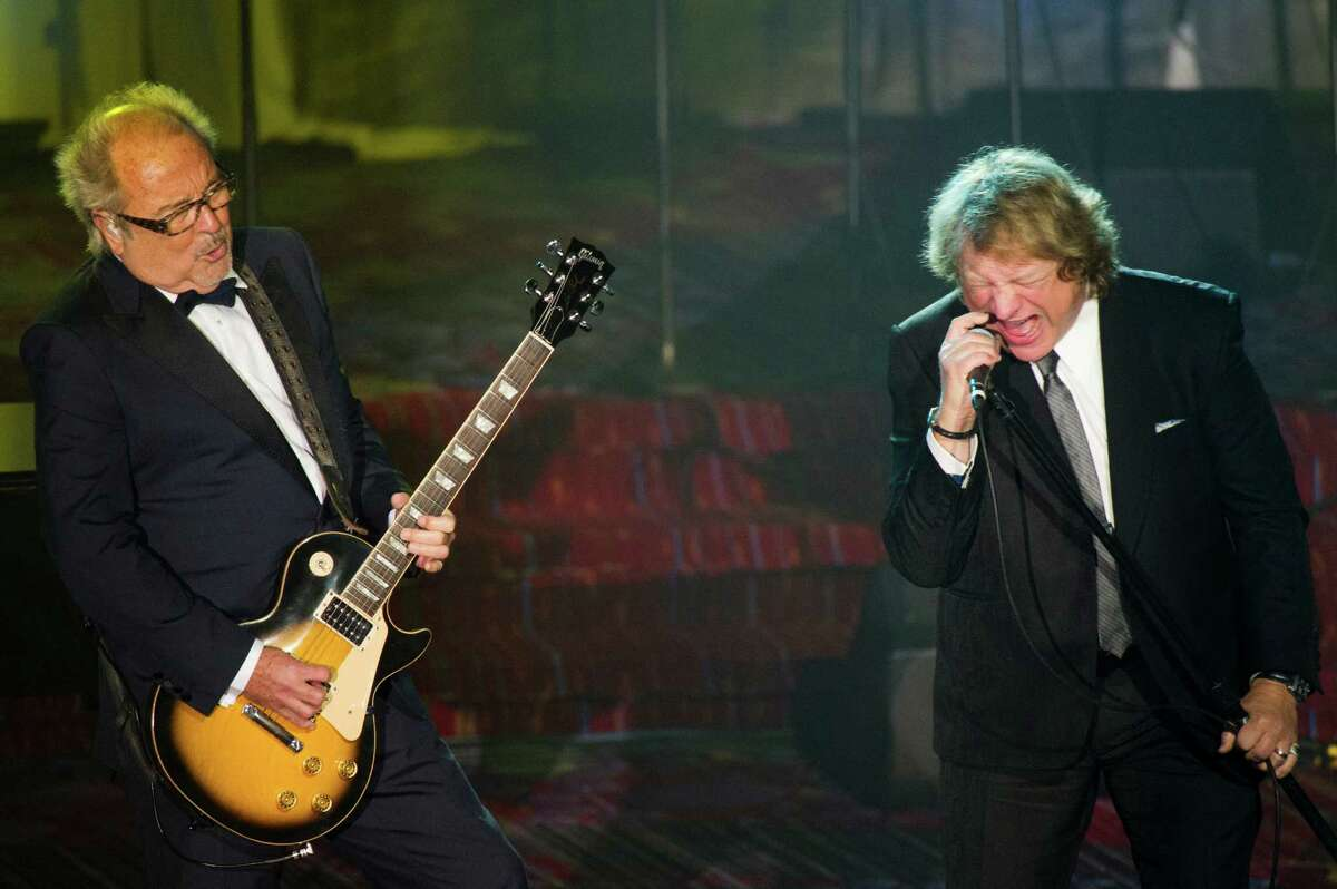 Mick Jones, left, and Lou Gramm from the band Foreigner perform at the Songwriters Hall of Fame 44th annual induction and awards gala on Thursday, June 13, 2013 in New York.