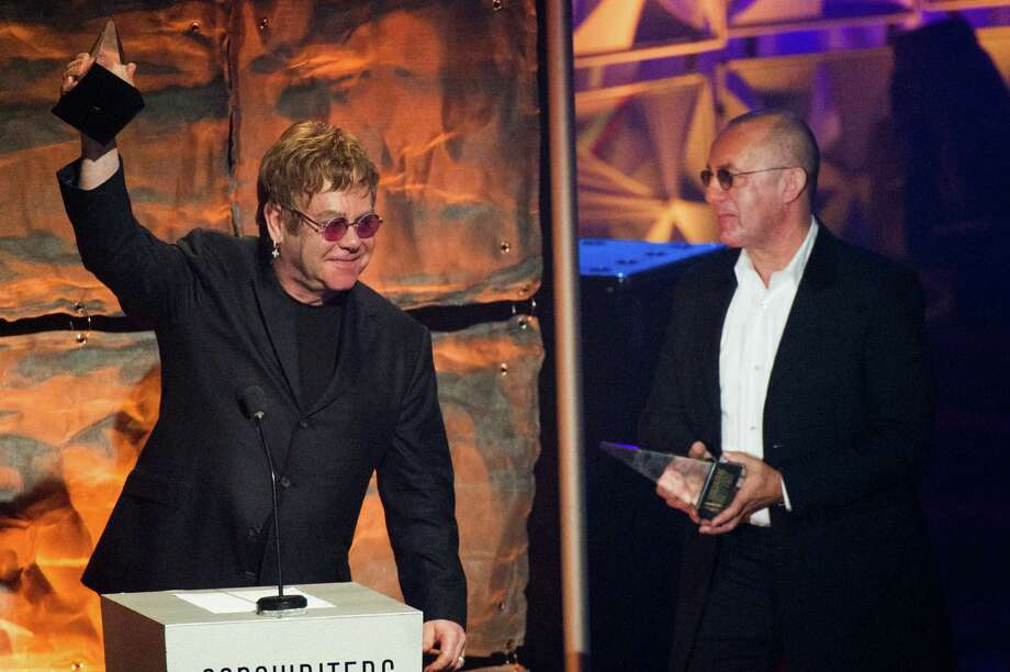 "Elton John, left, and Bernie Taupin accept the ""Johnny Mercer"" award at the Songwriters Hall of Fame 44th annual induction and awards gala on Thursday, June 13, 2013 in New York. Photo: Charles Sykes, Charles Sykes/Invision/AP / Invision"