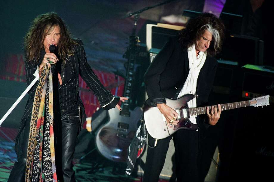 Inductees Steven Tyler, left, and Joe Perry from the band Aerosmith perform at the Songwriters Hall of Fame 44th annual induction and awards gala on Thursday, June 13, 2013 in New York. Photo: Charles Sykes, Charles Sykes/Invision/AP / Invision
