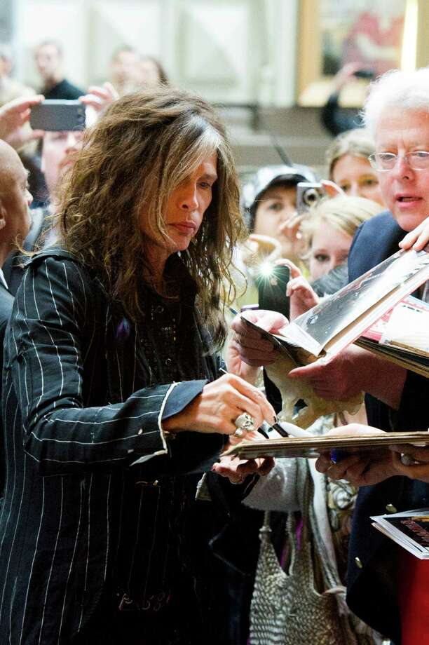 Inductee Steven Tyler signs autographs as he arrives to the Songwriters Hall of Fame 44th annual induction and awards gala on Thursday, June 13, 2013, in New York. Photo: Charles Sykes, Charles Sykes/Invision/AP / Invision