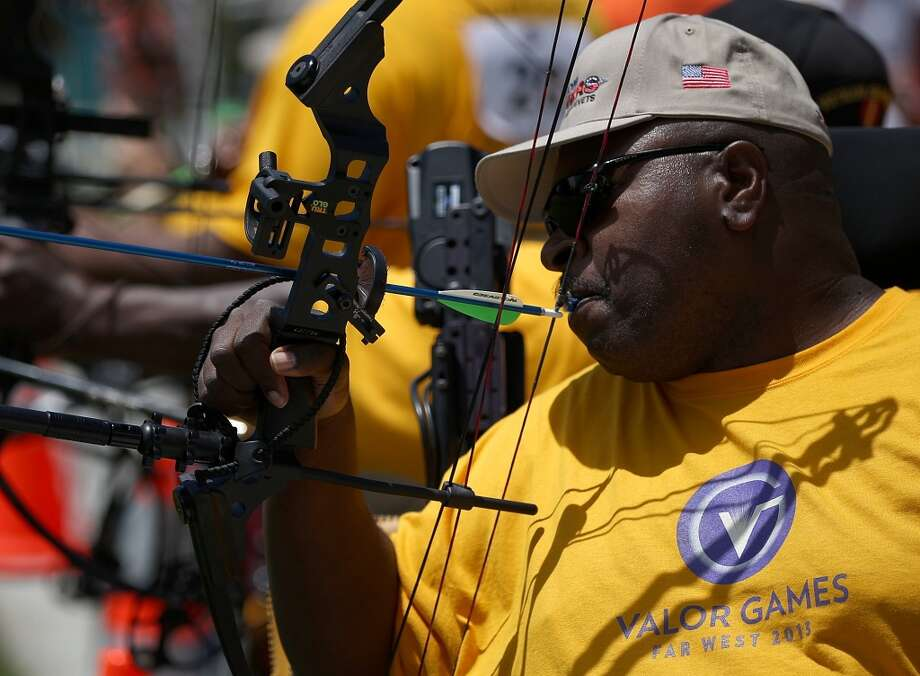 FOSTER CITY, CA - JUNE 11:  A competitor uses his mouth to pull back a bow and arrow during the archery competition at the inaugural Valor Games Far West on June 11, 2013 in Foster City, California.  Dozens of disabled and wounded military veterans are participating in the inaugural 3-day Valor Games Far West that is open to any veteran with a disability who is eligible for VA healthcare. The event is intended to introduce adapted sports to attendees. (Photo by Justin Sullivan/Getty Images)