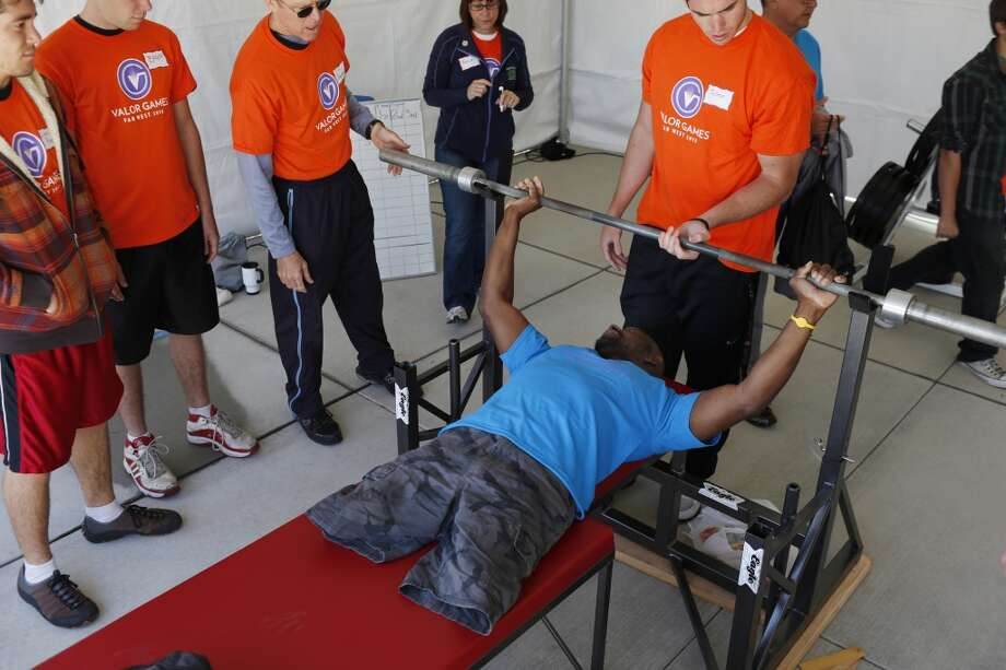 Army Sergeant Johnnie Alexander tests the height his lifting bar before competing in powerlifting during the second day of the Valor Games Far West at San Mateo College in San Mateo, Calif. on June 12, 2013.