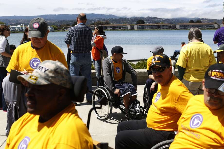 Wounded veterans wait for lunch during the first day of the Valor Games Far West in Leo J. Ryan Memorial Park in Foster City, Calif. on June 11, 2013.