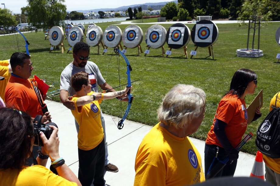Monica Delvecchio learns how to shoot archery during the first day of the Valor Games Far West in Leo J. Ryan Memorial Park in Foster City, Calif. on June 11, 2013.