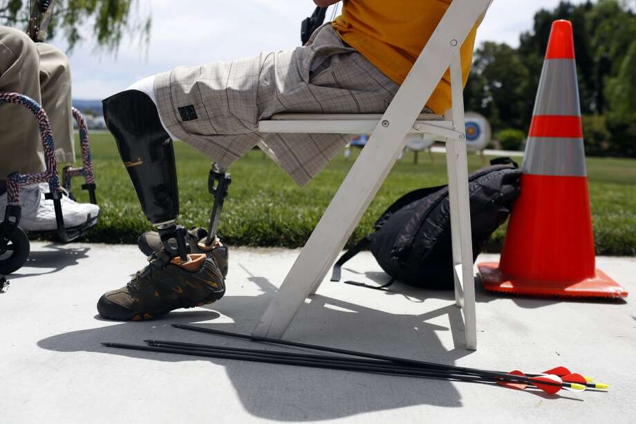 Arrows lay next to Joshua Hotaling's chair while he shoots archery during the first day of the Valor Games Far West in Leo J. Ryan Memorial Park in Foster City, Calif. on June 11, 2013. Hotaling is also an avid cyclist and diver.