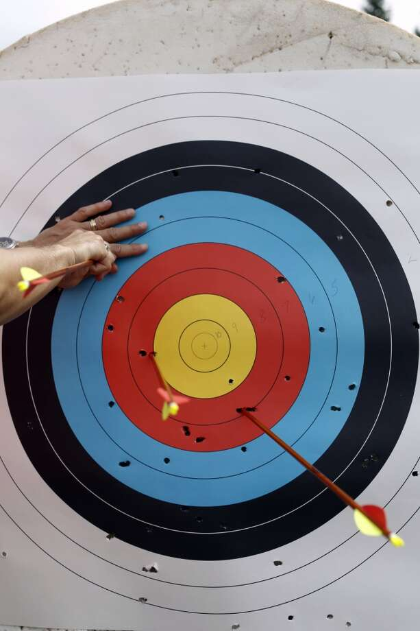 Arrows are pulled out of a target during the first day of the Valor Games Far West in Leo J. Ryan Memorial Park in Foster City, Calif. on June 11, 2013.