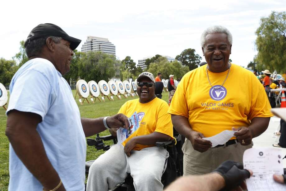 (left to right) Ron Davis, Larry Green and James J. Chretien Sr. joke after finishing the archery competition during the first day of the Valor Games Far West in Leo J. Ryan Memorial Park in Foster City, Calif. on June 11, 2013.