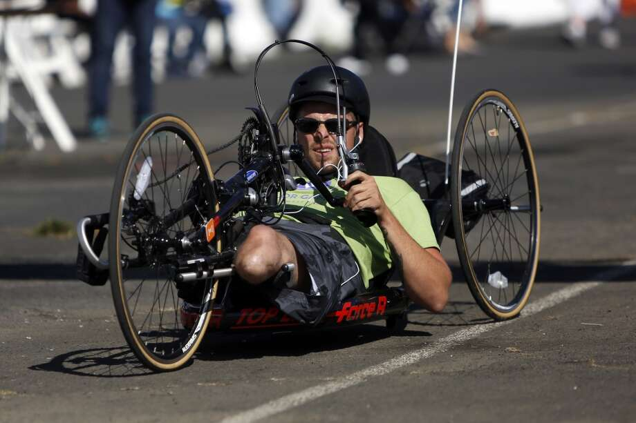 Marine Corporal Joshua Hotaling pedals his hand-bike at the cycling competition during the third day of the Valor Games Far West at Candlestick Park in San Francisco, Calif. on June 13, 2013.