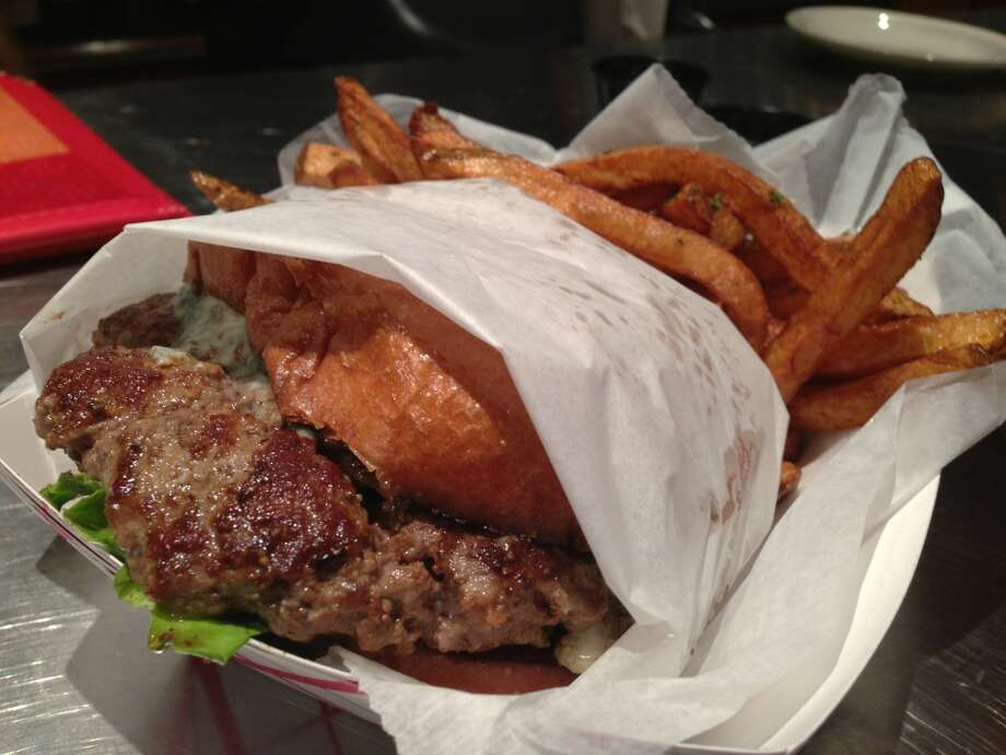 The blue cheese burger, $11.95, is not included in the happy hour.