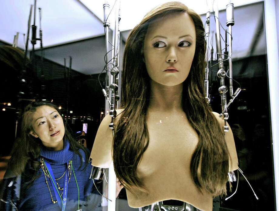 "A woman watches a full-scale figure of Terminator ""Cameron Phillipes"" at a preview of the Terminator Exhibition in Tokyo on March 18, 2009. Photo: YOSHIKAZU TSUNO, AFP/Getty Images / 2009 AFP"
