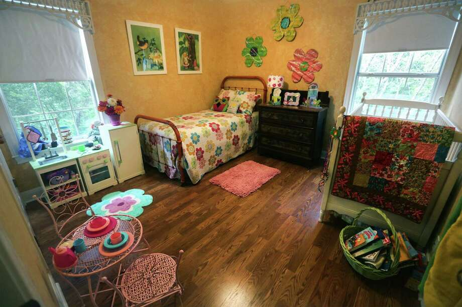 Empty nester Sue Peace turned two of her sons' bedrooms into rooms for her grandchildren in her Grey Forest home. She decorated this room for girls, shopping at sales, flea markets and craft shows. Photo: Bob Owen / San Antonio Express-News