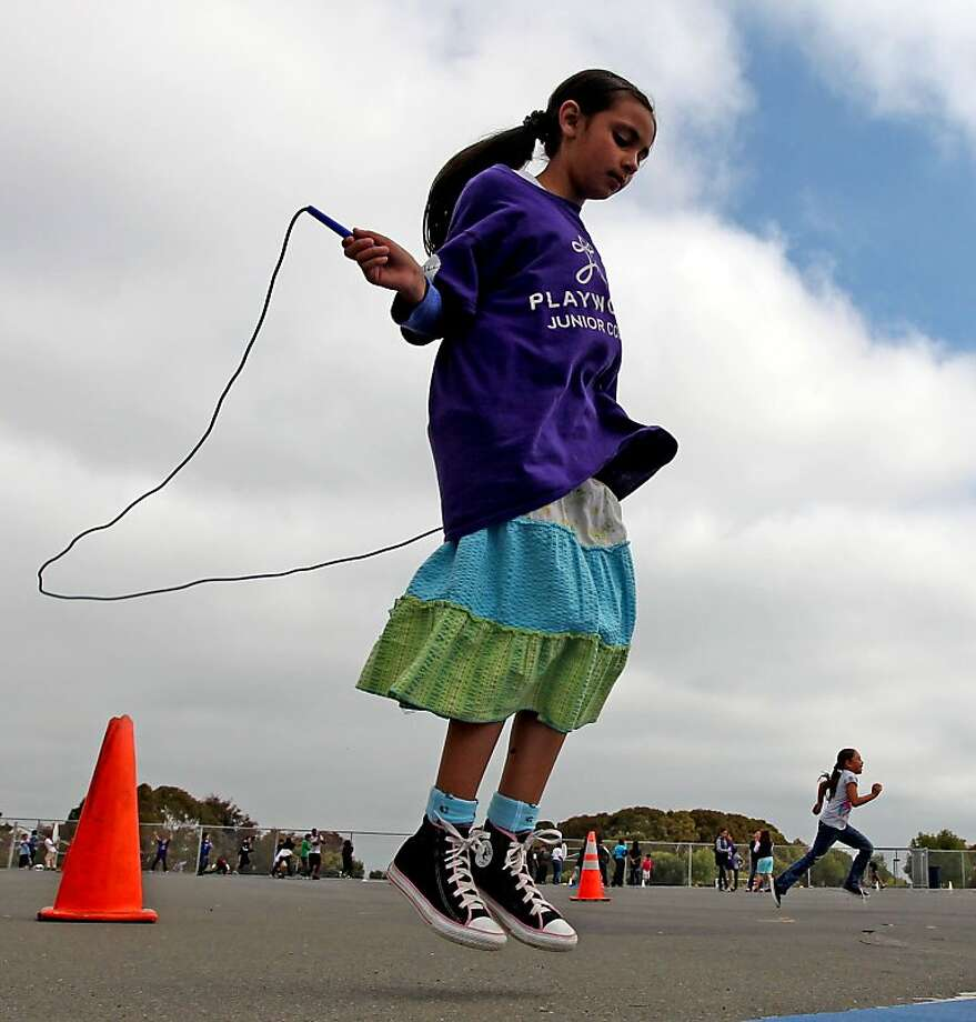 Ana Villareal, 9, a student at Montalvin Elementary School in San Pablo, jumps rope during recess organized by Playworks, a nonprofit that promotes exercise at a number of Bay Area schools. Photo: Lance Iversen, The Chronicle