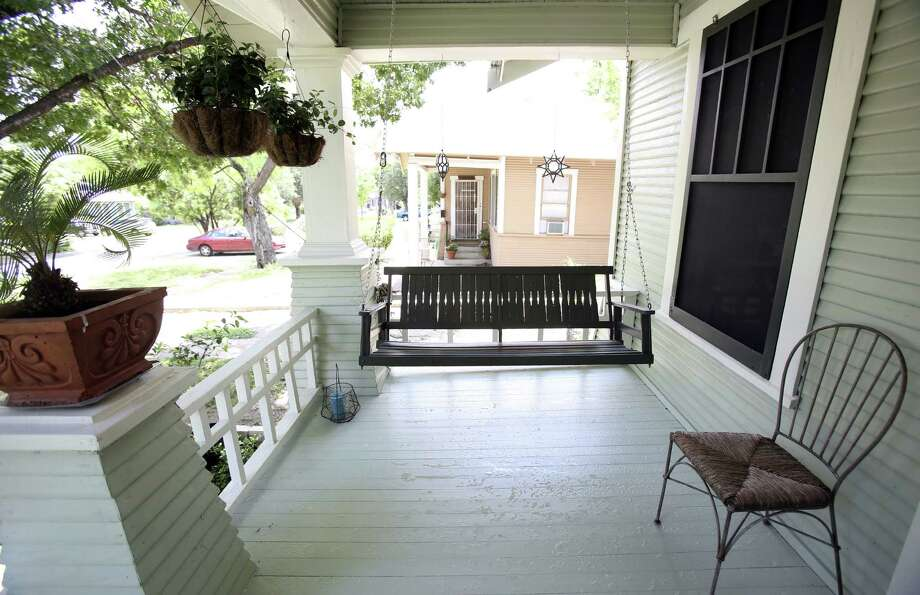 Kelly and Eric Morales live in a home that belonged to Kelly's grandparents. The front porch swing is one of the many features they have preserved from the grandparents' era. Photo: Photos By Helen L. Montoya / San Antonio Express-News