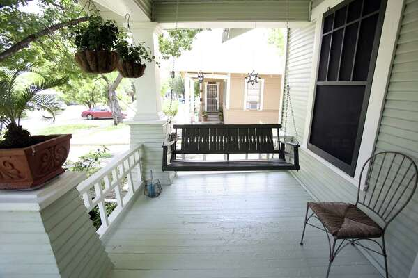 Kelly and Eric Morales live in a home that belonged to Kelly's grandparents. The front porch swing is one of the many features they have preserved from the grandparents' era.