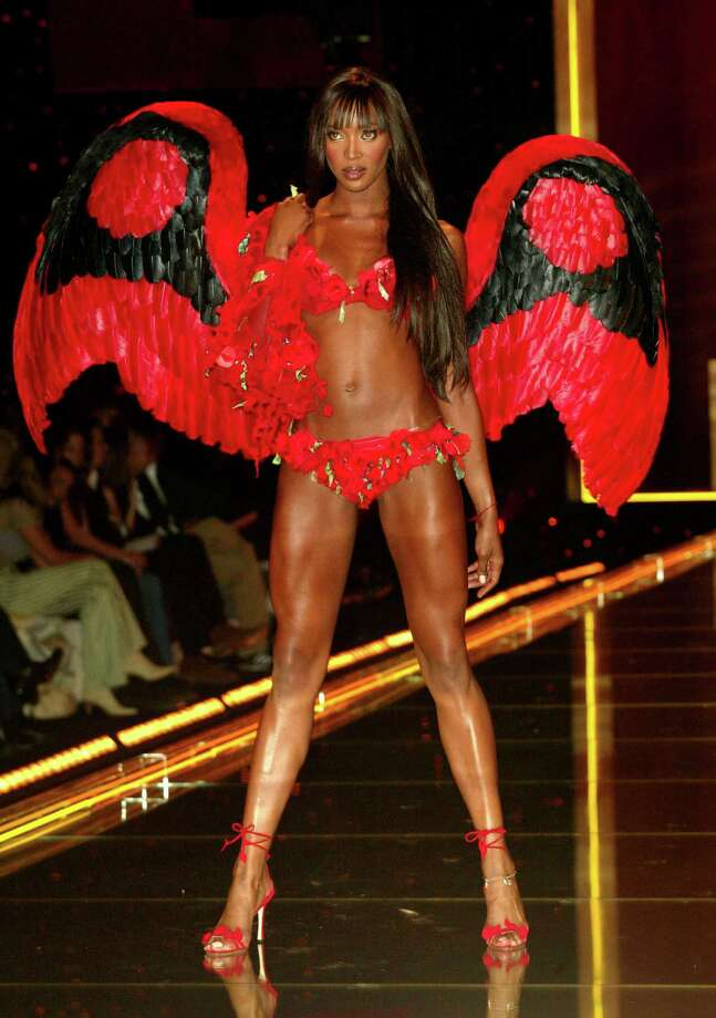 2002: Naomi Campbell walking the runway at the 2002 Victoria's Secret Fashion Show at Lexington Avenue Armory in New York City. November 14, 2002. (Photo by Evan Agostini/ImageDirect.) Photo: Evan Agostini, Getty Images / ©2002 Evan Agostini