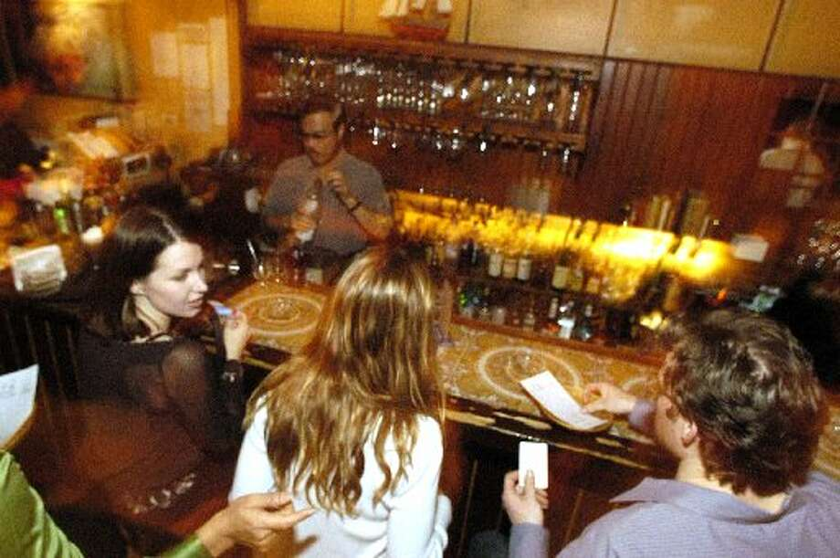 The way it was:  The bar area at Marfreless. Photo: Chron File