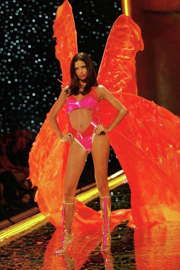 2002: Adriana Lima walking the runway at the 2002 Victoria's Secret Fashion Show at Lexington Avenue Armory in New York City. Photo: Evan Agostini, Getty Images / ©2002 Evan Agostini