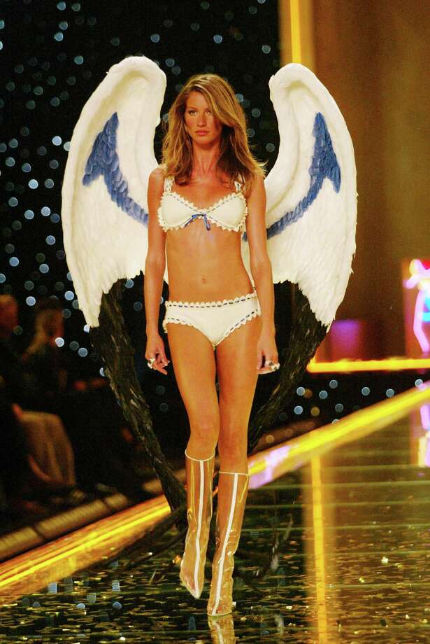 2002: Gisele Bundchen walking the runway at the 2002 Victoria's Secret Fashion Show at Lexington Avenue Armory in New York City. November 14, 2002. Photo: Evan Agostini, Getty Images / ©2002 Evan Agostini