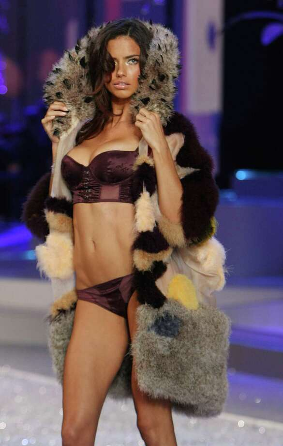 2008: Adriana Lima walks the runway at the Victoria's Secret Fashion Show at Fontainebleau on Nov.15, 2008 in Miami Beach, Fla. (Photo by John Parra/WireImage) Photo: John Parra, Getty Images / WireImage